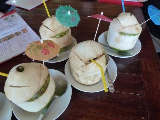 Kin Dee Restaurant: quench yr thirst....Coconut in Paradise island