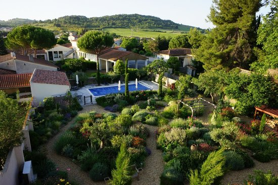 Maison Laurent : View of swimming pool, garden and beyond from Bedroom 5