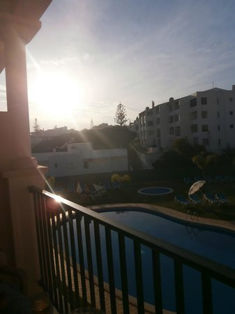 Aqua-Mar Aparthotel: watching the sun set from our balcony - poolside!