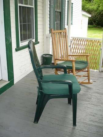 Three Stallion Inn: our private porch with comfy rocking chair
