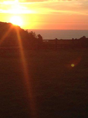Lower Campscott Farm : Sunset over the sea.