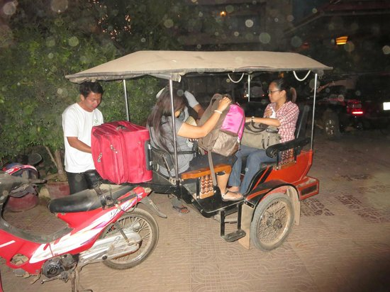 New Riverside Hotel: Mr How tuk Tuk driver preparing to  take some guests to the airport at Siem Reap.