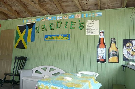 Yardie's Restaurant, Bar and Conch Stand : Signs in Yardie's Dining Room