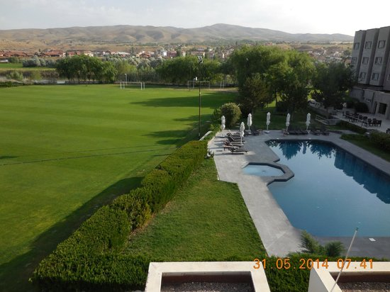 Avrasya Hotel: neighbouring field and pool