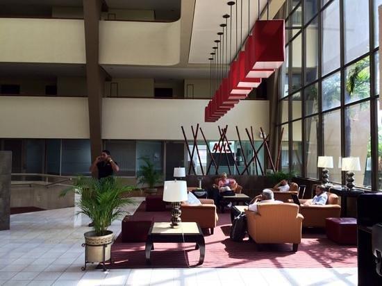 Crowne Plaza Hotel Corobici: front door Atrium seating area