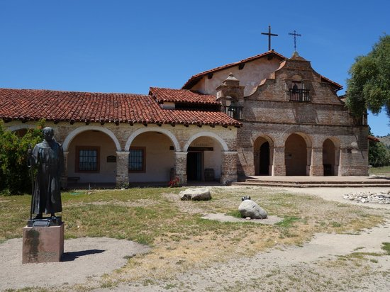 Exterior Of Mission San Antonio De Padua With Statue Of Father Junipero Serra
