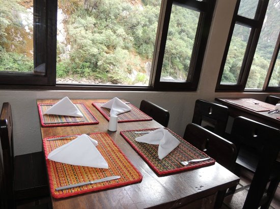 Toto's House: Our table by the window facing the river