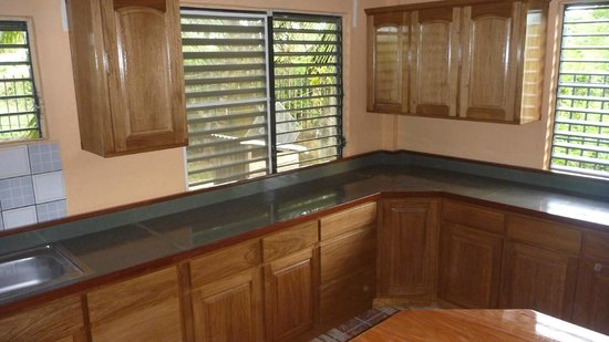Belize Wood Works Ltd.: Kitchen made out of Salmwood Base and Wall Cabinets