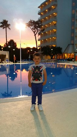 SuneoClub Haiti: My son next to the pool at sunset :) I want to go back now :(