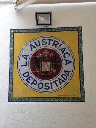 "Sign 'La Austriaca Depositada"" on the wall of the La Cruz Blanca"