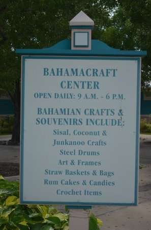 Bahama Craft Centre: Another sign on the entrance showing business hour and what they sell.