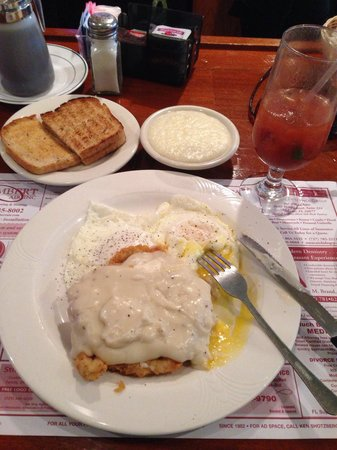 Daddy's Bar & Grill : Chicken Fried Pork Chop and Egg, grits and toast  Breakfast with a Bloody Mary.