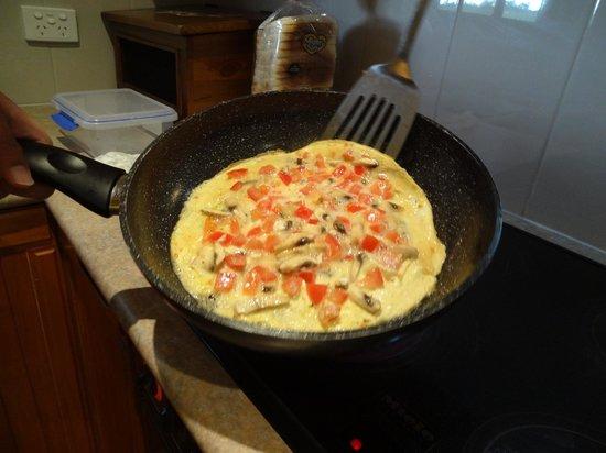Breakaway Farmstay: Omelete in progress