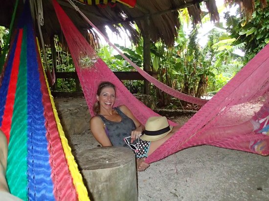 Lamanai Outpost Lodge: Communal area filled with hammocks...