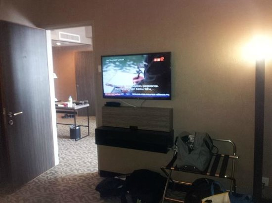 Grand Alora Hotel: 2nd flat screen TV in  suite room