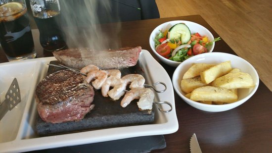 The Sizzling Stone : Duo of rump with surf and turf sizzling away