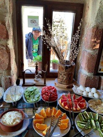 Safran Cave Hotel: Zekk goofing around during breakfast!