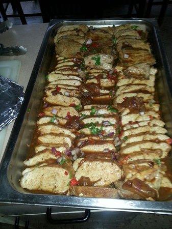 Pura Vida: Pork Loin, guava sauce.. Jazz fest