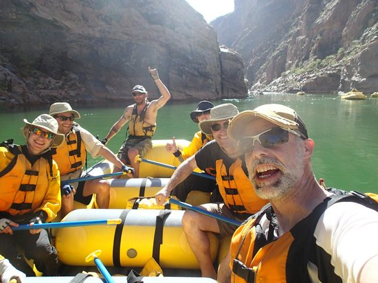 Outdoors Unlimited Grand Canyon Rafting : On the raft with Travis, our Outdoors Unlimited river guide