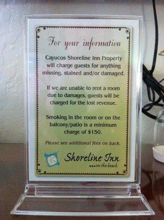 Cayucos Shoreline Inn...on the beach: Sign regarding missing/broken/damaged property