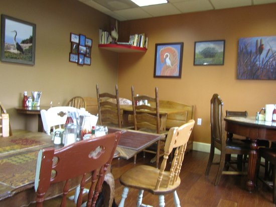 Pretty small inside but fun with different tables & chairs at each ...