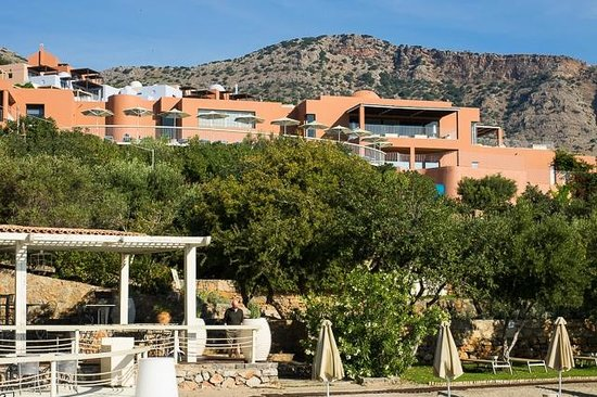 Domes of Elounda, Autograph Collection: from Topos restaurant looking up hill to suites