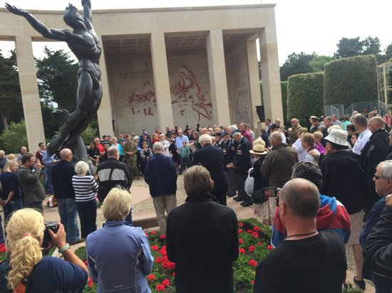 D-day Guided Tours : British ceremony at US cemetery at Omaha Beach on June 3, 2014.
