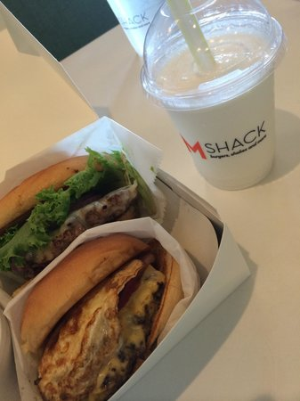 M Shack: Bacon cheeseburger with Swiss + Sunrise burger (with bacon and egg) + vanilla milkshake = YUM