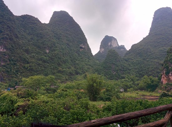 Yangshuo Phoenix Pagoda Fonglou Retreat : View from the rooftop where we had most of our meals. Moon hill in distance.
