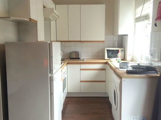 Brackenbury Serviced Apartments: Not the kitchen I expected based on photos