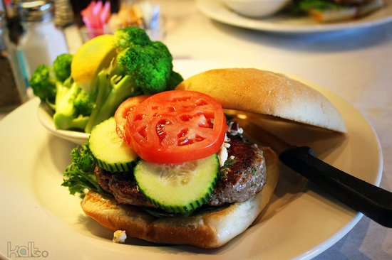 Manhattan Project Restaurant: Lamb burger with side of broccoli.