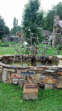 "Red Oak II : ""Plumbers nightmare"" titled fountain art. Really cool."