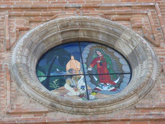 La Iglesia de Nuestra Senora de Guadalupe: Exterior View of Stain Glass Window