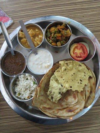 Bharawan Da Dhaba: That's the hot selling thali comprising the lachcha paranthas, paneer, aloo gobi, dal, raita..
