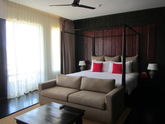 Bed with lounge in front. - Picture of Jetwing Yala, Palatupana ...