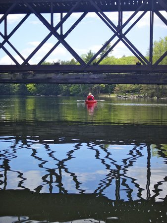 Sebago Trails Paddling Company: Reflections under a bridge