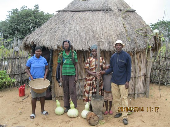 Nunda River Lodge: The village family with the millet basket