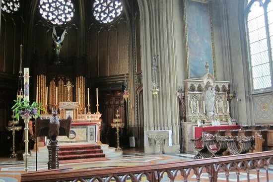Farnborough, UK: High Altar with organ behind and Shrine of St Joseph in transept