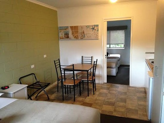 Motel Marengo : Kitchenette table, with room in the back w/two twin beds