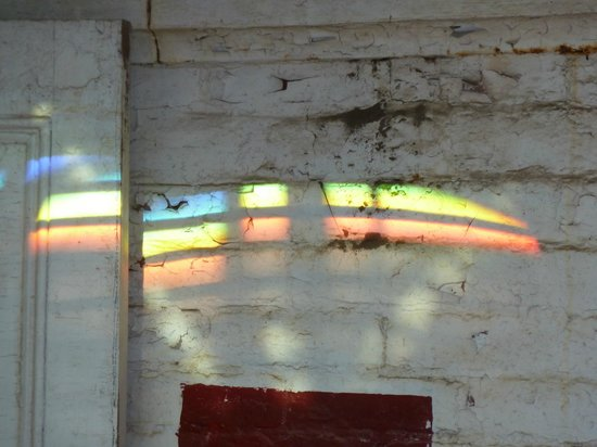 Southeast Lighthouse: View of the prism of the lens making these colors on the walls.