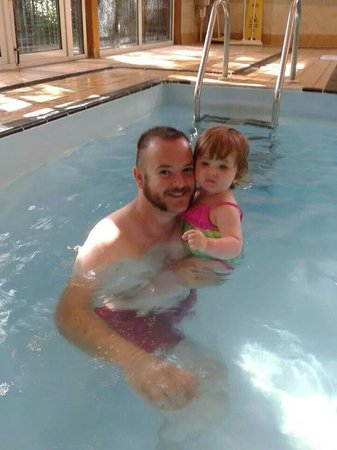 Marwell Hotel: My husband and daughter in the hotels pool