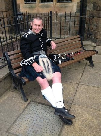 The Stirling Highland Hotel: Piper relaxing outside the hotel