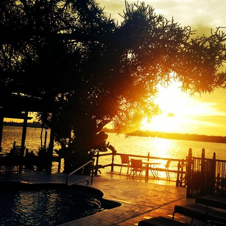 Turtle Beach Resort : Sunrise over the deck and pool- bay side