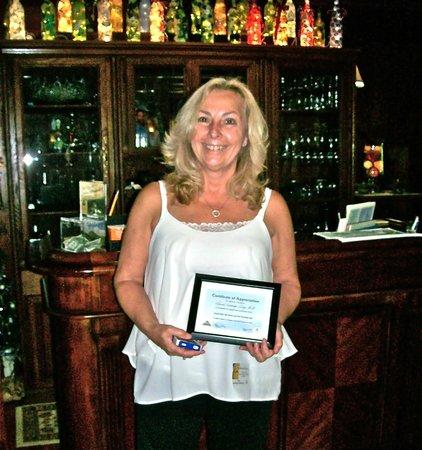 Laurel Springs Lodge B&B : Inn owner, Karen Berry, receives Certificate of Appreciation from Local club.