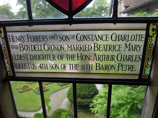 Baddesley Clinton: One of the many stained glass windows