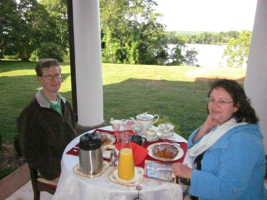 Belle Grove Plantation Bed and Breakfast : Breakfast on the porch.  the wine bottle was mine.