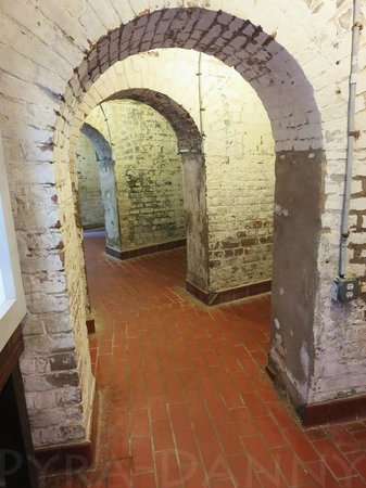 Old Fort Jackson: Area near the barracks. Each of those small rooms now hold a display relating to the fort's hist