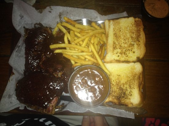 Lazy Croc BBQ: Delicious ribs platter with baked beans, French fries and toast.