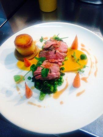 Salt Cafe: Roast lamb rump, carrot purée, broadies, peas, potato fondant