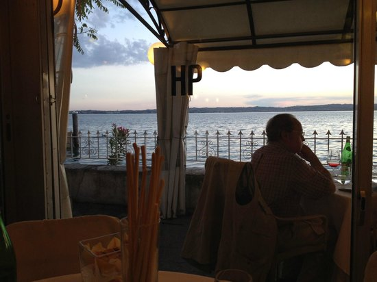 Ristorante Pace: Inside the dining room looking through the window to Lake Garda